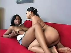 black lesbians play with sextoys on sofa
